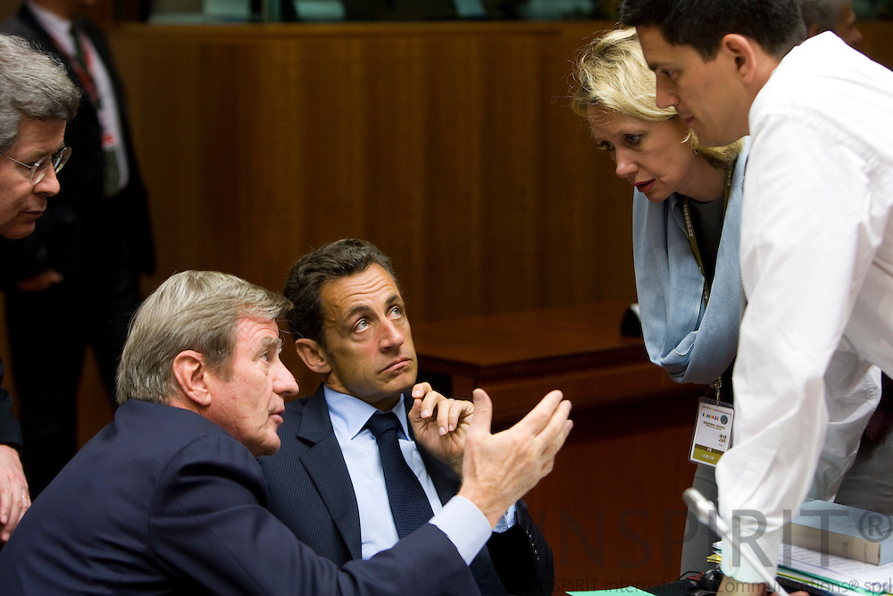 BRUSSELS - BELGIUM - 19 JUNE 2009 -- EU-Summit -- Sitting from left is the French Minister for Foreign Affairs Bernard KOUCHNER, French President Nikolas SARKOZY, an interpreter, the British Minister for Foreign Affairs David MILIBAND at the second day at the summit. The person standing on the left side is an unknown civil servant from France. Photo: Erik Luntang