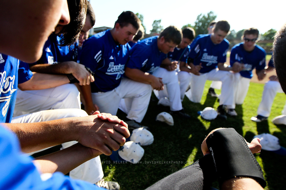 Members of the Valle Catholic Warriors hold hands for a prayer after a game against the Summit Christian Academy Eagles in the 2012 Missouri High School State Baseball Tournament at Meador Park on May 30, 2012 in Springfield, Missouri. (David Welker/TurfImages.com).