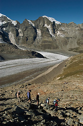 Switzlerland: Hiking the Swiss Glaciers near St. Moritz, taking the Diavolezza Morteratsch hike..Start of the hike with guide Paul Nigg..Photo copyright Lee Foster, 510/549-2202, lee@fostertravel.com, www.fostertravel.com..Photo #: swisse11433