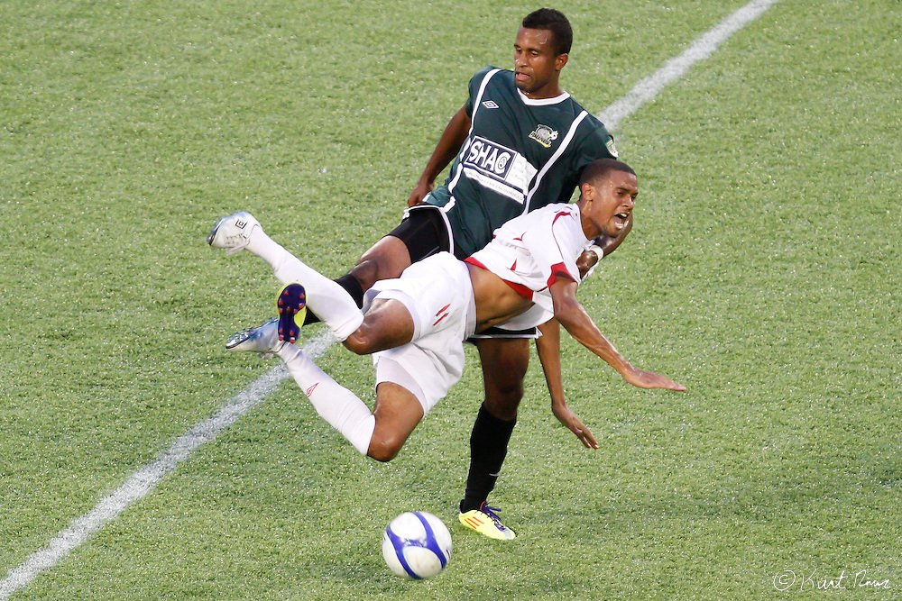 Max Griffin (11) of Orlando City fall over a Rochester player at the Citrus Bowl in Orlando, FL on July 17, 2011. Orlando City defeated the Rochester Rhinos 2-1. (Kurt Rivers/KnightNews.com)..