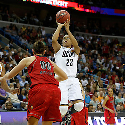 Apr 9, 2013; New Orleans, LA, USA; Connecticut Huskies forward Kaleena Mosqueda-Lewis (23) shoots against Louisville Cardinals forward Sara Hammond (00) during the first half of the championship game in the 2013 NCAA womens Final Four at the New Orleans Arena. Mandatory Credit: Derick E. Hingle-USA TODAY Sports