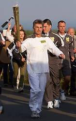 © Licensed to London News Pictures. 19/05/2012. Lands End, UK. Steve Brady carries the Olympic Flame out of Lands End ahead of its 8,000 mile journey across the UK. . Photo credit : Ashley Hugo/LNP