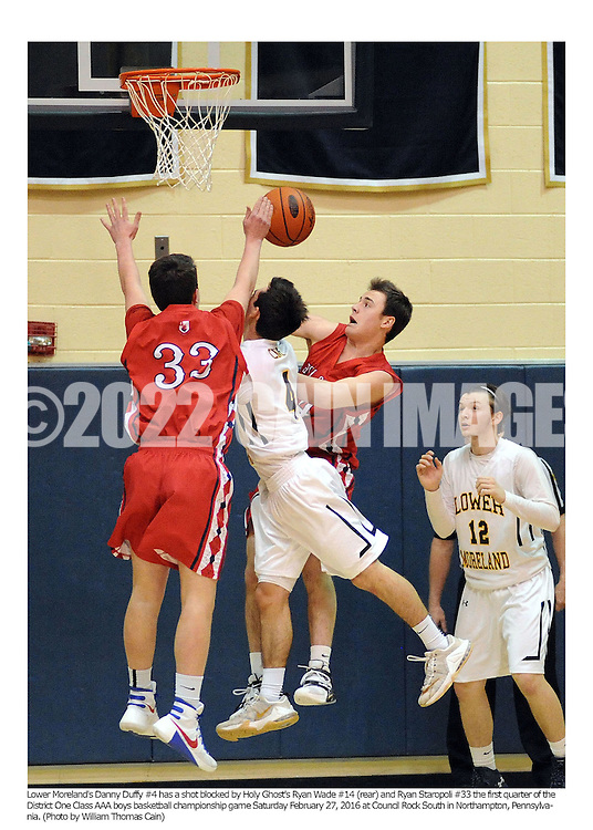 Lower Moreland's Danny Duffy #4 has a shot blocked by Holy Ghost's Ryan Wade #14 (rear) and Ryan Staropoli #33 the first quarter of the District One Class AAA boys basketball championship game Saturday February 27, 2016 at Council Rock South in Northampton, Pennsylvania. (Photo by William Thomas Cain)