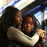(Boston, MA - 2/22/16) Teens cry and embrace during a vigil for stabbing victim Deon Hopkins at the scene of the stabbing on Columbia Road, Monday, February 22, 2016. Staff photo by Angela Rowlings.