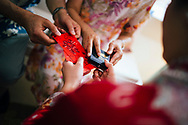 Gifts and jewellery are exchanged during the tea ceremony at a Chinese wedding, Ko Samui, Thailand, Southeast Asia