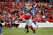 Nottingham Forest midfielder Adlene Guedioura (5)  and Reading striker Yakou Meite (21) during the EFL Sky Bet Championship match between Nottingham Forest and Reading at the City Ground, Nottingham, England on 11 August 2018.