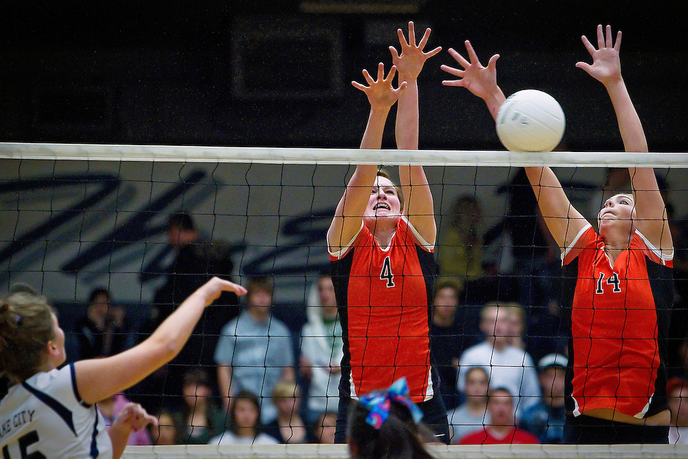 Post Falls High's Allison Meehan, center, and Sierra Monti successfully block a shot sent by Kadie Blank from Lake City High to close out the second set Tuesday.