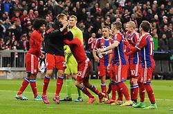 11.03.2015, Allianz Arena, Muenchen, GER, UEFA CL, FC Bayern Muenchen vs Schachtjor Donezk, Achtelfinal, R&uuml;ckspiel, im Bild Thomas Mueller (FC Bayern Muenchen) schiebt den Torschuetzen Holger Badstuber (FC Bayern Muenchen) nach vorne zu den Fans. // during the UEFA Champions League Round of 16, 2nd Leg match between FC Bayern Munich and Shakhtar Donezk at the Allianz Arena in Muenchen, Germany on 2015/03/11. EXPA Pictures &copy; 2015, PhotoCredit: EXPA/ Eibner-Pressefoto/ Stuetzle<br /> <br /> *****ATTENTION - OUT of GER*****