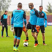 ALKMAAR - 27-07-2016, laatste training AZ voor Europese wedstrijd tegen Pas Giannina , AFAS Stadion, AZ speler Gino Coutinho, AZ speler Rens van Eijden met masker, AZ speler Stijn Wuytens.
