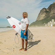 "Gabriel ""Popó"", 19, surfer. When he was 6, Bocão taught him to surf. Since then his dream is to became a professional surfer competitor, and a week ago he made the final and placed third in Rocinha Surfers Association first contest. One of Rocinha best surfers, he spends the whole day at the beach – a way to avoid his alcoholic parents at home. Although he is a very talented surfer, he doesn't have that kind of family structure and doesn't go to school. Lives at infamous Rua 2, drug dealers HQ, but thanks to surfing he didn't end up in organized crime's hands. His three young brothers also surf."