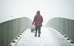 © Licensed to London News Pictures. 27/02/2020. Stokenchurch, UK. A woman takes a walk in the early morning in h eavy snowfall in Stokenchurch, Buckinghamshire, England, as the south east is hit by snow for the first time in 2020. Large parts of the UK are experiencing heavy flooding with flood barriers being breached in worst hit areas. Photo credit: Ben Cawthra/LNP
