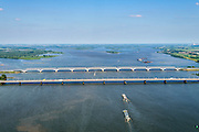 Nederland, Zuid-Holland, Hollandsch Diep 10-06-2015; Moerdijkbruggen over Hollandsch Diep. Brug voor autoverkeer (A16) in de voorgrond, spoorbruggen op het tweede plan. Gezien naar Nieuwe Merwede en Biesbosch.<br /> Bridges across Hollands Diep, motorway and two railway bridges.<br /> luchtfoto (toeslag op standard tarieven);<br /> aerial photo (additional fee required);<br /> copyright foto/photo Siebe Swart