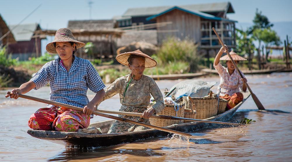 Three women on boat in Inle Lake (Myanmar)