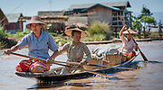 Three women on boat in Inle Lake (Myanmar)