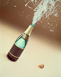 Exploding spray from champagne bottle