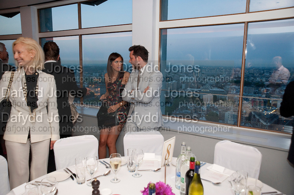 DASHA ZHUKOVA;  DEREK BLASBERG;, Dinner hosted by Julia Peyton-Jones and Hans Obrist for the Council of the Serpentine to celebrate: Jeff Koons, Popeye Series. Paramount Club, Paramount Centre Point. London. 30 June 2009