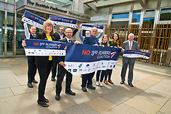 Pictured: Members of the No 3rd Runway Coalition were joined by MSPs, Alison Johnstone (Green Party) MPatrick Harvie (Green Party) Andy Whghtman (Green Party), and Neil Gil Patterson (SNP)<br /> <br /> The No 3rd Runway Coalition was at the Scottish Parliament today to urge the SNP to change their position on supporting the Heathrow third runway proposal and to send the UK Government a message to 'think again'. Campaigners will be joined by MSPs from Scottish Greens, and SNP to highlight the environmental damage to Scotland and the rest of the UK that building a third runway would mean, as well as the fact that Scottish airports would suffer as a result.  Campaigners also believe that the SNP appear to be too trusting of UK Government promises &ndash; particularly in relation to the impact on Climate Change commitments - as revealed by Keith Brown, Cabinet Secretary for Economy, Jobs and Fair Work, in response to a question from Patrick Harvie MSP in the Scottish Parliament last Thursday.<br /> <br /> The Labour party announced their formal opposition to the proposal on Wednesday, on the basis that the UK Government&rsquo;s Airports National Policy Statement failed all four of party&rsquo;s tests on climate change, delivering extra capacity, air pollution and benefits to be felt outside of London. Additionally, the long-awaited UK Government mitigation framework for international aviation emissions won't be published for many months after MPs have been asked to support the Heathrow proposal. A recent report by the New Economics Foundation seriously calls into question the economic case &ndash; using the Department for Transport&rsquo;s own measures; and this is before taking into account the economic impact of Brexit <br /> <br /> <br /> <br /> Ger Harley | EEm 21 June 2018