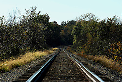 20 October 2007:  Railroad tracks are lined by the colors of fall foilage.
