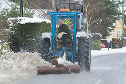 A tractor driver clears snow at Glentunnel, inland Canterbury, New Zealand, Thursday, July 13, 2017. Credit:  SNPA / David Alexander -NO ARCHIVING-