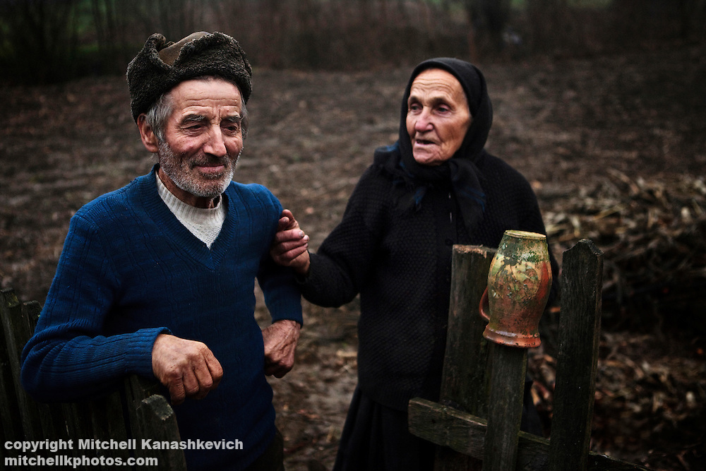 Elderly rural Romanian husband and wife communicaitng. Maramures, Romania