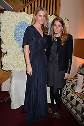Left to right, LADY KINVARA BALFOUR and PRINCESS BEATRICE OF YORK at a party hosted by Lady Kinvara Balfour, Lavinia Brennan and Lady Natasha Rufus Isaacs to celebrate the Beulah French Sole Collaboration in aid of the UN Blue Heart Campaign, held at George, 87-88 Mount Street, London on 10th December 2013.