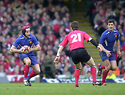 07/03/2004 Six Nations Rugby - Wales v France.Vincent Clerc, runs at Ceri Sweeney [No.21] with the ball....   [Mandatory Credit, Peter Spurier/ Intersport Images].