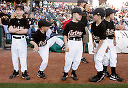 Members of the Gregory-Portland Pee Wee Astros wait on the sidelines before they walk out on the field with the members of the Hooks baseball team before the start of the Hooks exhibition game against the Houston Astros at Whataburger Field in Corpus Christi.