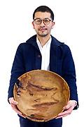 artist Kazuto Yoshikawawith one of his wood works Tokyo 2018