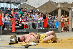© Licensed to London News Pictures. 26/08/2017. London, UK. Members of the Brittania re-enactment group put on Gladitorial Games in Guildhall Yard, the site of London's only Roman Amphitheatre.  The Gladiator Games will be entertaining crowds over the August Bank Holiday Weekend. Photo credit : Stephen Chung/LNP