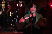 Dec. 6, 2013 - Brooklyn, NY. Ann Marie Awad makes some general announcements before the start of the Audiofiles live show at the Jalopy Theatre in Red Hook, Brooklyn. 12/6/13 Photograph by Julius C. Motal/CUNY Journalism PHOTO