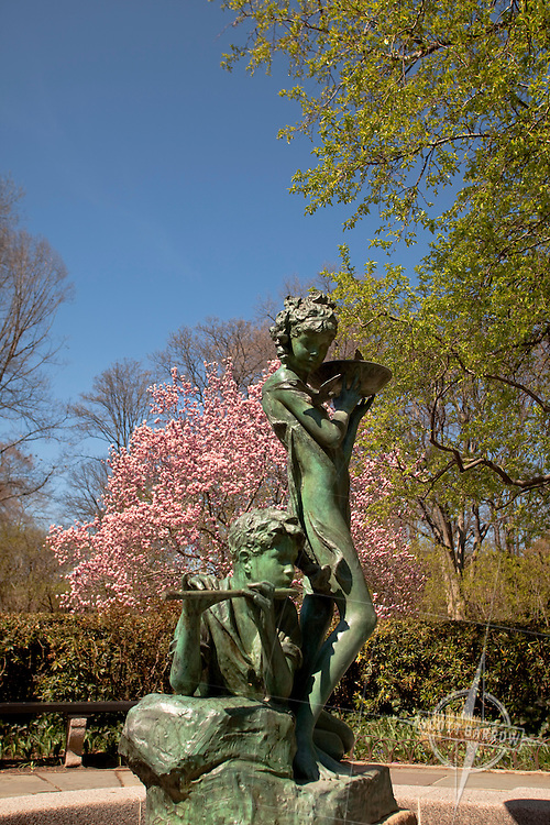 "The Conservatory Garden in Central Park, NYC. Fall colors. The English Garden's Burnett Fountain depicting Dickon and Mary from the book ""The Secret Garden"""