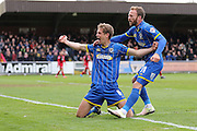 Sean Rigg forward for AFC Wimbledon (11) and Paul Robinson defender for AFC Wimbledon (6) celebrates his goal during the Sky Bet League 2 match between AFC Wimbledon and Crawley Town at the Cherry Red Records Stadium, Kingston, England on 16 April 2016. Photo by Stuart Butcher.