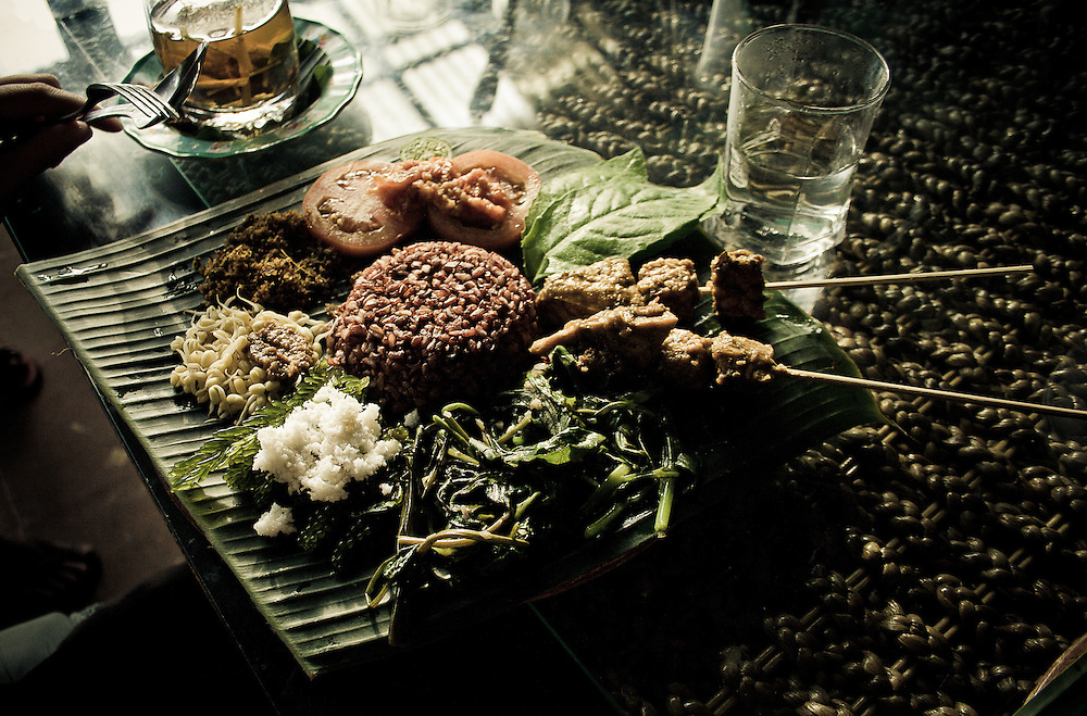 The Vitamin Lunch consists of  water spinach, tempeh, tofu, ginger, coconut, bean sprouts, papaya, tomato chutney and red rice at Wayan's Balinese Traditional Healing Center made famous by the book 'Eat, Pray, Love' in Ubud, Bali, Indonesia.