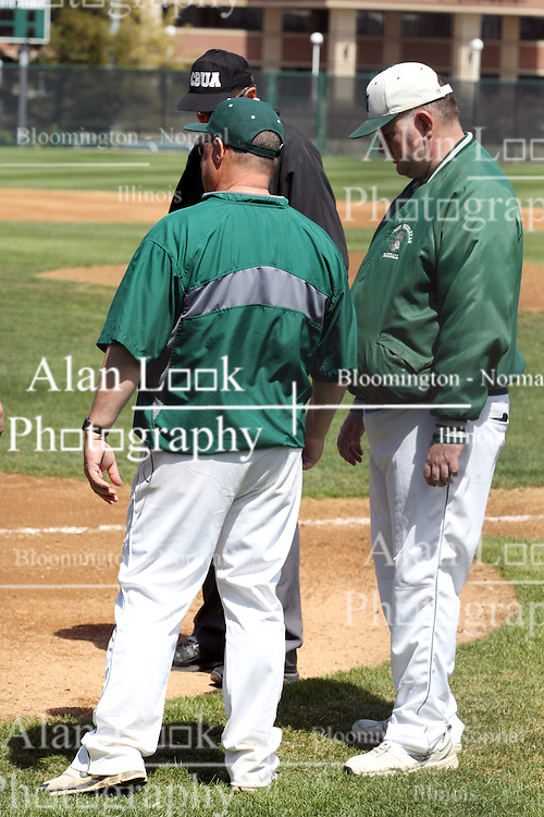 """14 April 2013:  Titan Head Coach Dennis Martel and Director of Baseball Operations Matt """"the cat"""" Adams during an NCAA division 3 College Conference of Illinois and Wisconsin (CCIW) Baseball game between the Elmhurst Bluejays and the Illinois Wesleyan Titans in Jack Horenberger Stadium, Bloomington IL"""