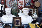 Cultural revolution relics, including busts of Mao Zedong for sale in Beijing's infamous Panjiayuan Market May 28, 2006. The market started out as an unofficial flea market back in the early 90's but has quickly grown in size and popularity. Open on Saturday and Sunday, Panjiayuan's treasure trove of antiques and oddities now has approximately 3,000 registered stallholders, and up to 50,000 visitors on a busy day. Whether you're looking for that 14th century Ming vase or Cultural Revolution kitsch, be sure to start early. Panjiayuan opens at 4.30am and it's best to hit the market before everyone else does.
