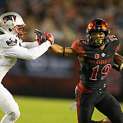 08 October 2016: The San Diego State Aztecs football team open's up the mountain west conference season at home against the University of Nevada Las Vegas Lobos. San Diego State running back Donnel Pumphrey (19) rushes the ball for a first down in the first quarter. The Aztecs lead the Lobos 13-7 at halftime. www.sdsuaztecphotos.com