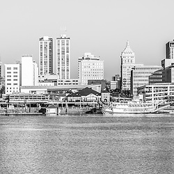 Peoria panorama black and white photo og the Peoria skyline with downtown city buildings along the Illinois River waterfront and the Spirit of Peoria riverboat. Panorama photo ratio is 1:3.