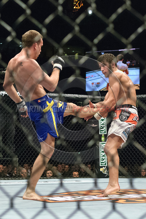 """NEWCASTLE, ENGLAND, UNITED KINGDOM, JANUARY 19 2008: Per Eklund (left) has his kick caught by Sam Stout during """"UFC 80: Rapid Fire"""" inside the Metro Radio Arena in Newcastle, England on January 19, 2008."""