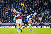 Matt Targett (Aston Villa) & Aaron Mooy (Brighton) during the Premier League match between Brighton and Hove Albion and Aston Villa at the American Express Community Stadium, Brighton and Hove, England on 18 January 2020.Matt Targett (Aston Villa)