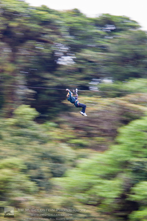 A person passes by on a zip line at high speed in the Monteverde Cloud Forest Reserve in Selvatura Adventure Park, Costa Rica