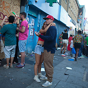 The streets are emptying quickly as the sun sets and the parades are over. Lovers in Portobello Road.. The Notting Hill Carnival has been running since 1966 and is every year attended by up to a million people. The carnival is a mix of amazing dance parades and street parties with a distinct Caribbean feel.