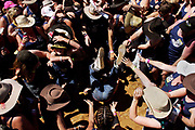 """A man falls while taking part in the blue singlet count at the annual Deniliquin Ute Muster in Deniliquin, Australia. A """"ute"""" is a term used in Australia for a utility vehicle, popular in the rural areas and used for farming and other work needs."""