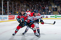 KELOWNA, CANADA - NOVEMBER 17: Tate Olson #4 of the Lethbridge Hurricanes checks Liam Kindree #26 of the Kelowna Rockets during third period on November 17, 2017 at Prospera Place in Kelowna, British Columbia, Canada.  (Photo by Marissa Baecker/Shoot the Breeze)  *** Local Caption ***