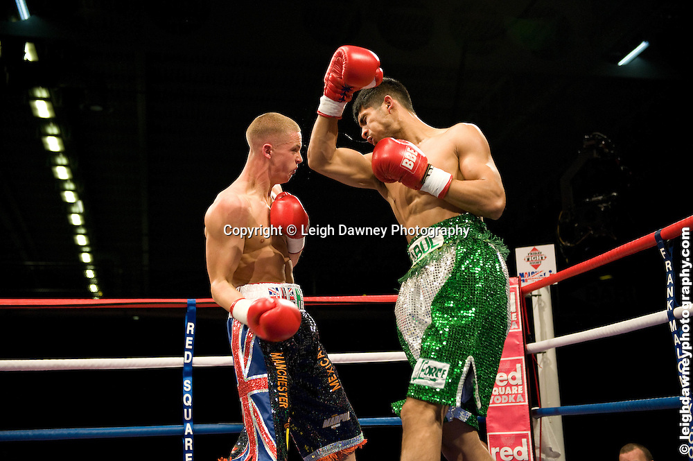 Karl Place (black shorts) defeats Abul Taher at the Bolton Arena, Bolton, UK on 23rd September 2009. Frank Maloney Promotions. photo credit © Leigh Dawney