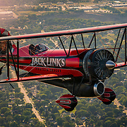 Renowned aerobatic pilots Sean D. Tucker, flying the Oracle Challenger III, and Jeff Boerboon, flying the Jack Link's Screamin' Sasquatch, take to the skies over EAA's 2015 AirVenture Oshkosh, on Monday, July 20, 2015 in Oshkosh, Wis. More than 500,000 people will attend the world's largest air show in Wisconsin this week. (Matt Ludtke/AP Images for Jack Link's)