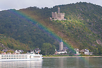 Germany, River Rhine. Rainbow glowing castle nestled in the wooded hills above the River Rhine in southern Germany.