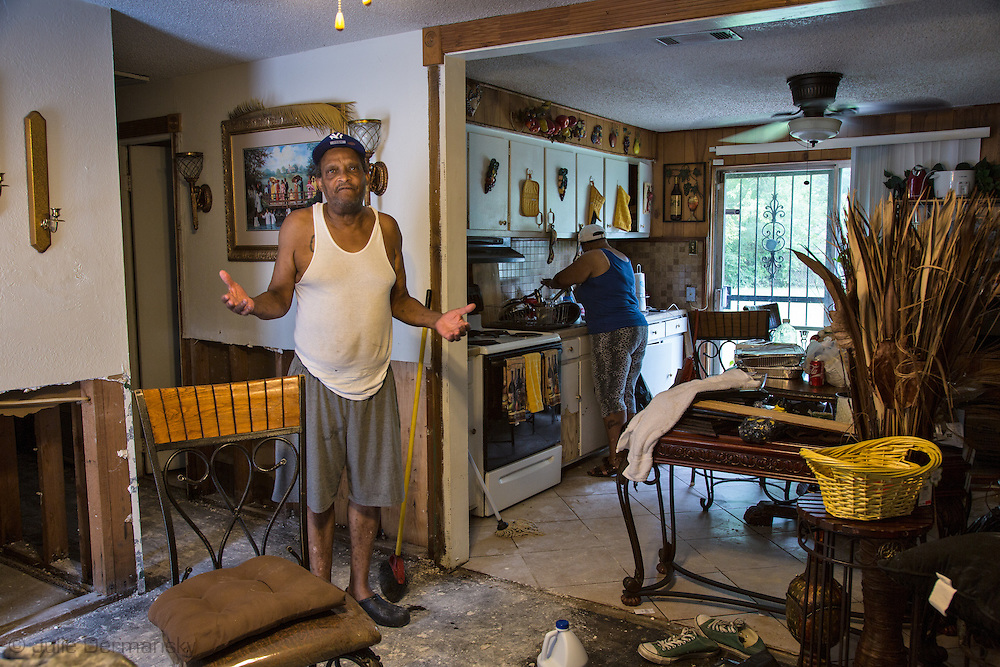 Sonia Vincent and her father Leroy James in her flooded home in East Fariline, a subdivision in Baton Rouge. Vincent and her family members are staying in the house as they try to fix it becuase they have no where else to go. FEMA visited her but didnt' tell her how much money she would get to assist her in getting back on her feet yet.