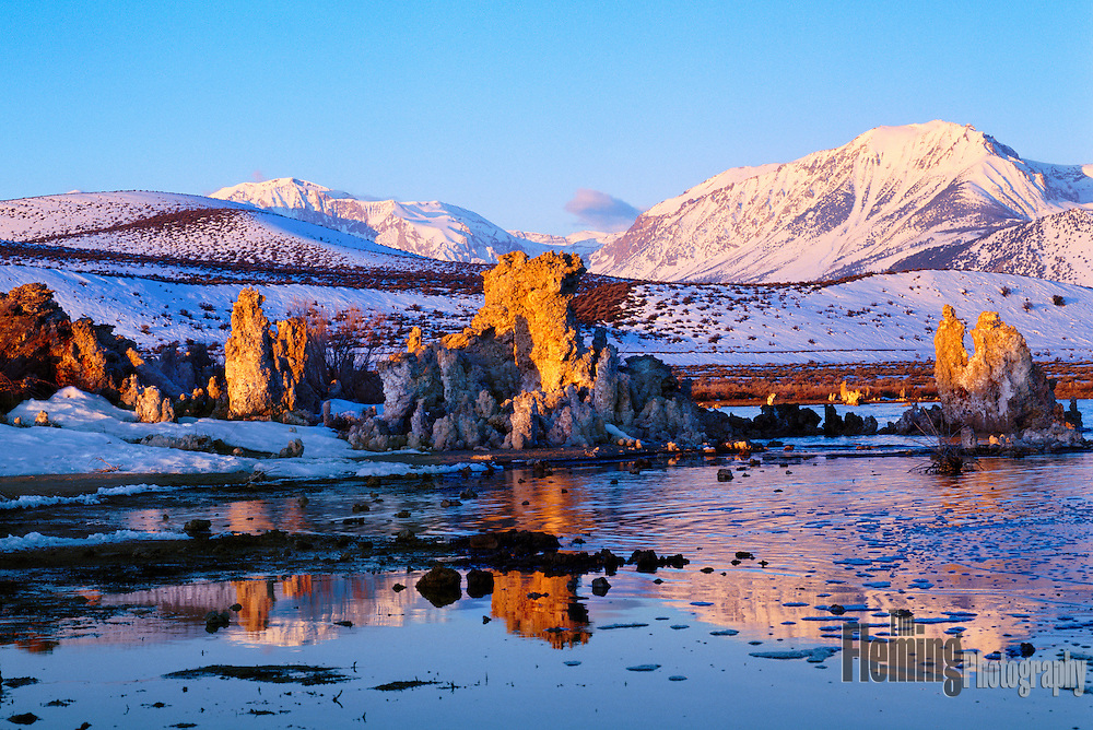 Tufa towers glow with the first light of the day