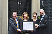 © Licensed to London News Pictures. 11/06/2013. Westminster, UK LEFT TO RIGHT Adrian Sanders MP, Penny Mordaunt MP and Caroline Lucas MP.  Dr Nick Palmer, Director of Policy at the BUAV. An open letter to Lord Taylor of Holbeach is handed into Downing Street today 11th June 2013 The letter from the British Union for the Abolition of Vivisection (BUAV) calls on the Government to set up an independent inquiry into animal suffering. Photo credit : Stephen Simpson/LNP
