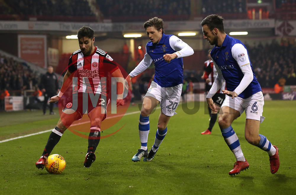 George Baldock of Sheffield United takes on Adam Reach of Sheffield Wednesday and Morgan Fox of Sheffield Wednesday - Mandatory by-line: Robbie Stephenson/JMP - 12/01/2018 - FOOTBALL - Bramall Lane - Sheffield, England - Sheffield United v Sheffield Wednesday - Sky Bet Championship